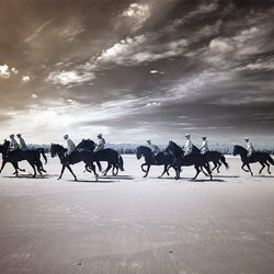 Infrared photograph of the Cavalry galloping across Holkham sands Norfolk.