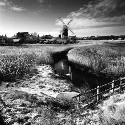 Black and white photograph of the windpump at Cley Norfolk.