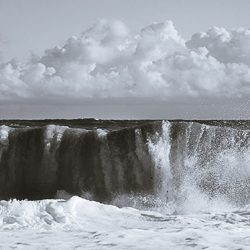 Tri-tone photograph of a wave crashing ashore at Cromer Norfolk.