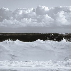 Tri-tone photograph of waves crashing on to the beach at Cromer Norfolk.