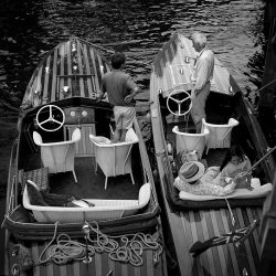 Black and white photograph of old motor boats on the Thames.