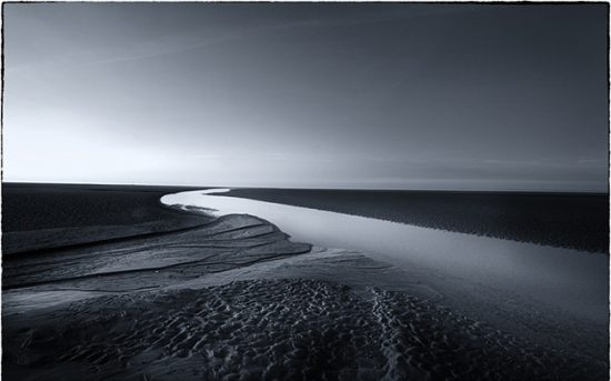 A tri-tone photograph of Holkham sands Norfolk.