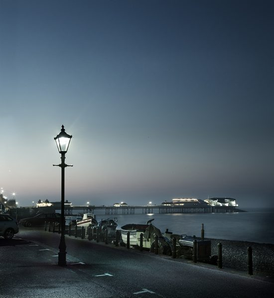 Photograph taken at dusk of Cromer pier and lamplight.